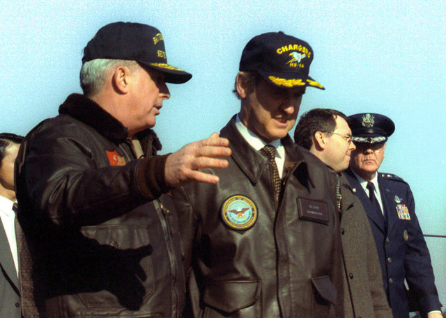 Secretary of Defense William H. Cohen speaks with US Navy Rear Admiral Charles W. Moore, Jr., Commander, Independence Battle Group. Cohen met with Moore while onboard USS INDEPENDENCE (CV 62). In an address to the Sailors of Independence, Cohen announced that the Indpendence Battle Group would relieve the NIMITZ (CVN 68) Battle Group (not shown) in the Persian Gulf