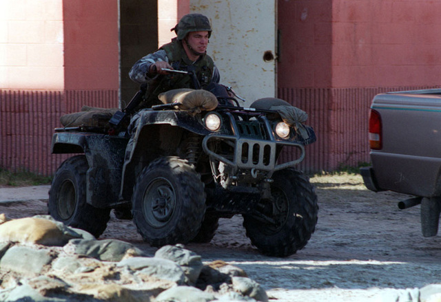 The Grizzly, an all terrain vehicle (ATV), maneuvers over rubble at the MOUT (Military Operations in Urban Terrain) facility during LOE 1 (Limited Objective Experiment 1). Urban Warrior is the U.S. Marine Corps Warfighting Laboratory's series of limited objective experiments examining new urban tactics and experimental technologies