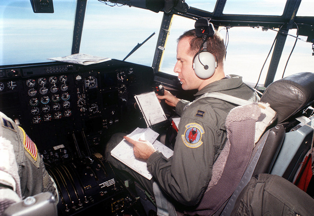 United States Air Force Captain Mike Irwin, a Pilot with the 50th Airlift Squadron out of Little Rock Air Force Base, Arkansas, flies a C-130 Hercules aircraft. Captain Irwin and his crew will be delivering personnel, equipment and supplies (not shown) to Tuzla Air Base in Bosnia and Herzegovina, in support of Operation Joint Guard