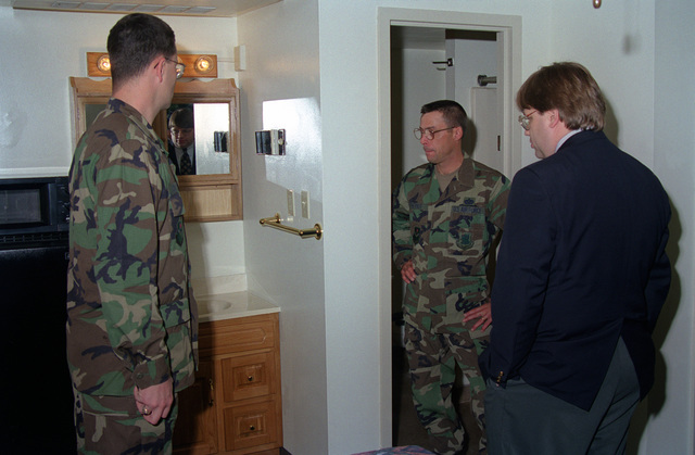 US Air Force personnel, Major Hutchinson and STAFF Sergeant Theriot, 81st Civil Engineering Squadron (CES) show Mr. Paul Juola, House Appropriations Committee, renovations made to permanent party dormitories