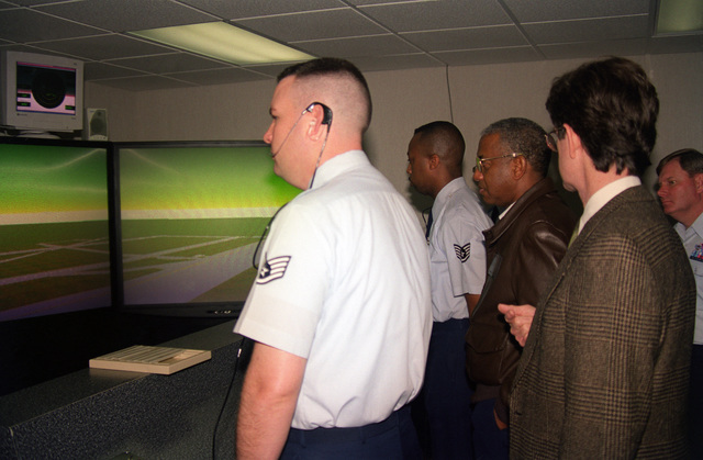 US Air Force personnel, STAFF Sergeant (SSGT) Mike Carroll and SSGT Daniel Williams, demonstrate to US Air Force General Lloyd W. Newton, AETC Commander Randolph Air Force Base, Texas, the 334th Training Squadron, Air Traffic Control Training Flights newest Air Traffic Control simulator. It uses computer based training and current operational software to prepare airfield operation personnel to operate and manage airfields