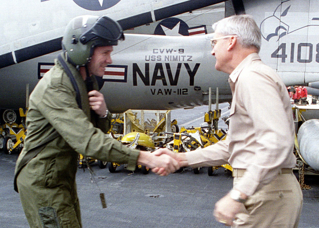 US Navy Rear Admiral John B. Nathman, Commander, Carrier Group Seven, (right) greets British Royal Navy Rear Admiral Ian Forbes, Commander, United Kingdom Task Group, during his visit to the aircraft carrier USS NIMITZ (CVN 68). Nimitz and the British Royal Navy aircraft carrier HMS INVINCIBLE are deployed to the Persian Gulf in support of Operation SOUTHERN WATCH