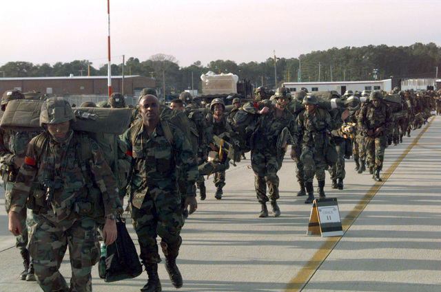Some of the 1,300 paratroopers from 82nd Airborne Division, Fort Bragg, North Carolina are seen arriving at the flightline to be loaded onto waiting C-141B Starlifters which will airdrop them over Sicily Drop Zone during JTFX 98-1. (Duplicate image, see also DD-SD-01-05231 or search 970129-F-0697K-005)