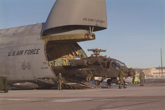 An Air Force Reserve C-5 Galaxy from 433d Military Airlift Wing, Kelly AFB, Texas delivers two AH-64 Apache helicopters to Eielson AFB to take part in NORTHERN EDGE '98, an annual Joint Chiefs of STAFF winter exercise involving air and ground units of all services. The Apaches are assigned to the 4th Battalion, 3d Armored Cavalry Regiment at Fort Carson, Colorado and will j