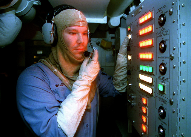 Gunners Mate 3rd Class John Wiederhold tests a Vertical Launch System (VLS) panel aboard USS JOHN S. MCCAIN (DDG 56). MCCAIN is deployed to the Persian Gulf in support of Operation Southern Watch