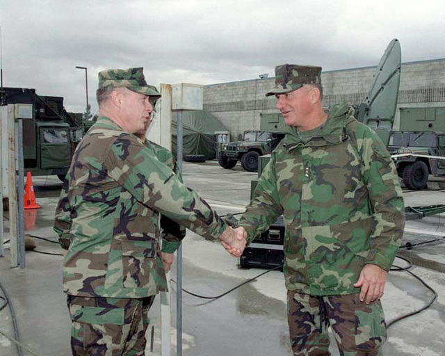 COL Thomas, 9th Communications Battalion Commanding Officer welcomes LGEN Jefferson Davis Howell Jr., Commander, Marine Corps Forces Pacific, top the 9th Communications compound. LGEN Howell is wearing the new Gortex Parka which is the top half of the 2nd Generation Extended Cold Weather Clothing System (ECWCS). (SCREEN RESOLUTION ONLY)