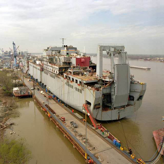 Port quarter view of the Military Sealift Command (MSC) Bob Hope Class Vehicle Transport Ship USNS FISHER (T-AKR 301), tied up at the fitting out pier at the Avondale Industries, Shipyard Division. This progress photo shows the ship at 80 % completion