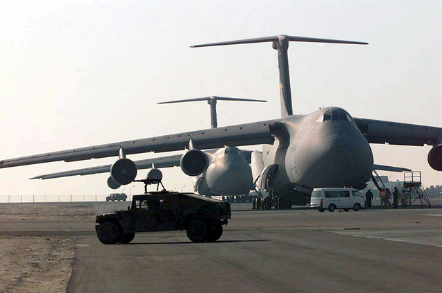 C-5 Galaxy cargo aircraft from Dover Air Force Base (AFB), Delaware and Travis AFB, California, prepare to off-load equipment at the Kuwait City International Airport in support of Operation SOUTHERN WATCH 1998