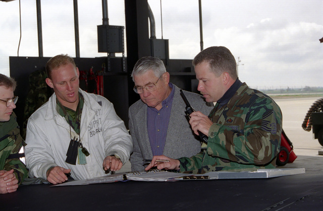 SENIOR MASTER Sergeant (SMSGT) Tommy Rowell, right and STAFF Sergeant (SSGT) Jeff Boot, 99th Reconnaissance Squadron, discuss US Air Force forms with CHIEF MASTER Sergeant of the Air Force (CMSAF), Robert Gaylor, center