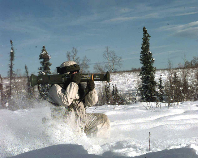 SPC Russell Garcia from B Co., 1ST Battalion, 17th Infantry, Fort Wainwright, Alaska, fires an anti-tank weapon (AT-4) at a jeep in the village of Simpsonville, Alaska during NORTHERN EDGE '98, an annual Joint Chiefs of STAFF winter exercise involving air and ground units of all services. SPC Garcia (in winter attire) is also wearing the MILES (multiple Integrated Laser Engagement Simulation) equipment on his body as well as on the helmet. The MILES receivers will beep when targeted by a weapon equipped with the MILES laser emitter, indicating a kill or wounding of the wearer. (Substandard image)