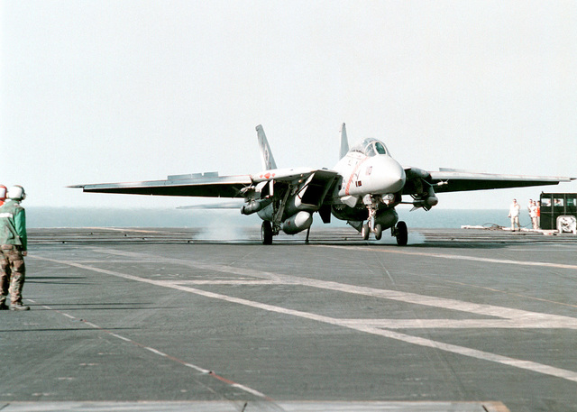 A US Navy F-14B Tomcat, Fighter Squadron One Zero Two (VF-102) makes an arrested landing on the flight deck of the nuclear powered aircraft carrier USS GEORGE WASHINGTON (CVN 73). The GEORGE WASHINGTON and VF-102 are currently conducting operations in the Persian Gulf to enforce UN sanctions against Iraq. Operation SOUTHERN WATCH, 25 February 1998