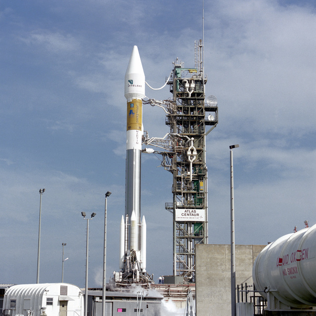 An Intelsat communications satellite awaits its trip into orbit atop a Lockheed Martin Atlas II AS launch vehicle (AC-151) on complex 36B at Cape Canaveral