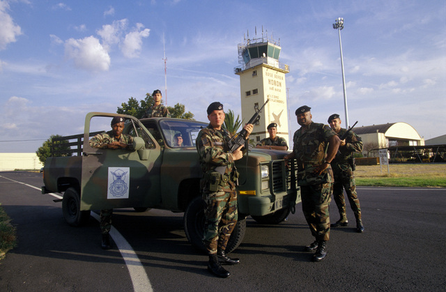 Armed with 5.56mm M16A2 Semiautomatic Rifles, a United States Air Force Security Forces team provides flight line and base security for permanent party personnel deployed to Moron Air Base