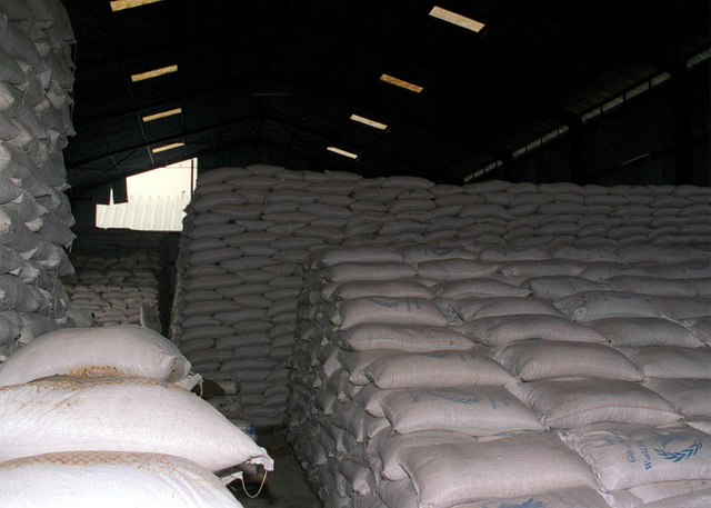 A World Food Programme (WFP) warehouse in Garissa shows the massive amount of food that is stockpilled prior to being shipped to the flight line to be loaded onto pallets for air delivery during Joint Task Force Kenya, operation Noble Response. (Duplicate image, see also DM-SD-02-04677 or search 980303-M-4605W-002)