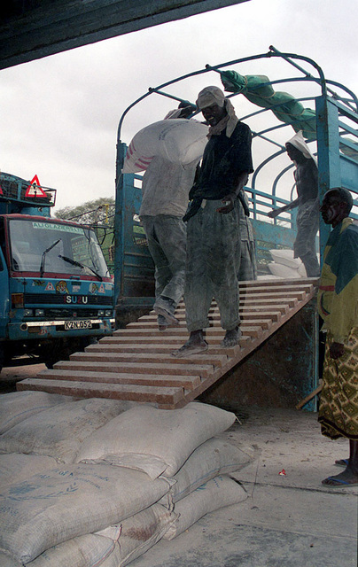 Workers at the World Food Programme (WFP) warehouse in Garissa, load corn onto the 8-10 ton truck used to transport food to Dadob, since the roads to Dadob have been repaired after the flooding