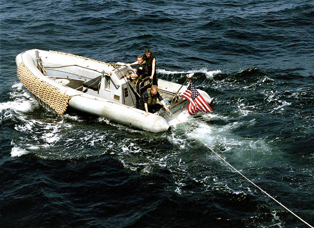 Sailors from USS SAMUEL B. ROBERTS (FFG-58) leave the ship in a Rigid Hull Inflatable Boat (RHIB) to rig up a towing line to a disabled Iranian fishing boat. ROBERTS (not shown) was patrolling the Arabian Sea in support of the Southwest Asia (SWA) build-up when she received orders to assist this ship in distress
