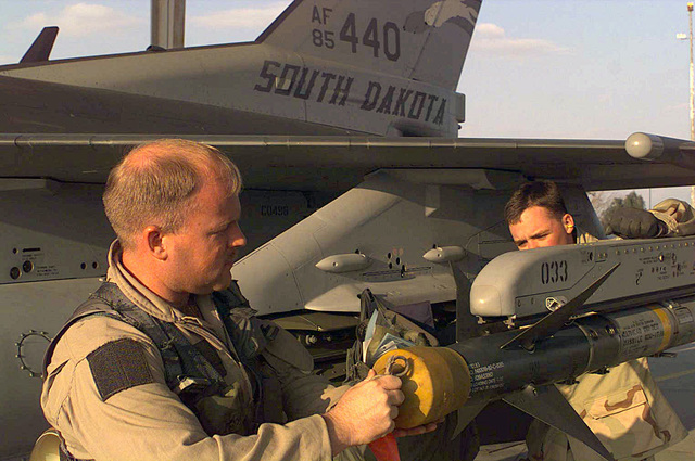 Captain (CAPT) Brian English, an F-16 Fighting Falcon pilot assigned to the 114th Fighter Wing (FW), Air National Guard (ANG), Joe Foss Field, Sioux Falls, South Dakota, pre-flight checks his aircraft at Al Jaber Air Base, Kuwait, in support of Operation SOUTHERN WATCH 1998
