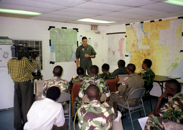 Major Coffman the Air Officer for Joint Task Force Kenya, briefs Kenyan Government Officials on the Marine Corps involvement in flood relief efforts in support of Joint Task Force Kenya, operation Noble Response