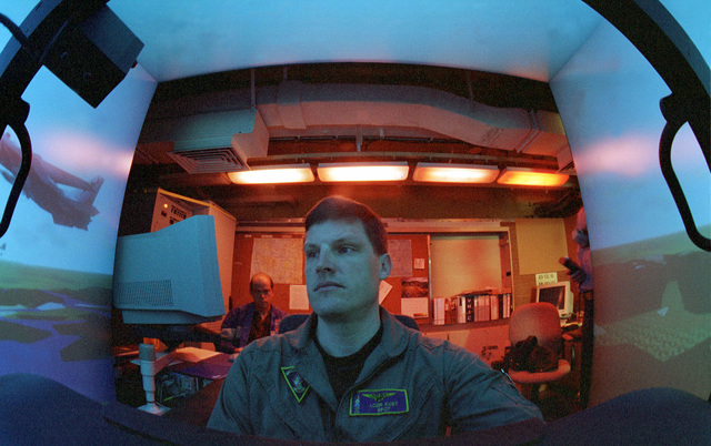 US Navy Lieutenant Commander Bryan Kust sits in a F/A 18 Hornet flight simulator aboard the Forrestal Class Aircraft Carrier, USS INDEPENDENCE (CV 62). The USS INDEPENDENCE is forward deployed to the Persian Gulf in support of Operation Southern Watch