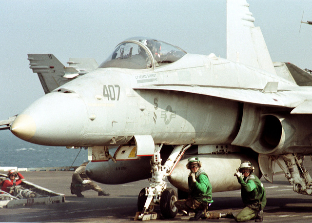 "A US Navy F/A-18 ""Hornet"" attached to Strike Fighter Squadron 195 (VFA-195) readies for launching from the Forrestal Class Aircraft Carrier, USS INDEPENDENCE (CV 62). The INDEPENDENCE is deployed to the Persian Gulf in support of Operation Southern Watch"