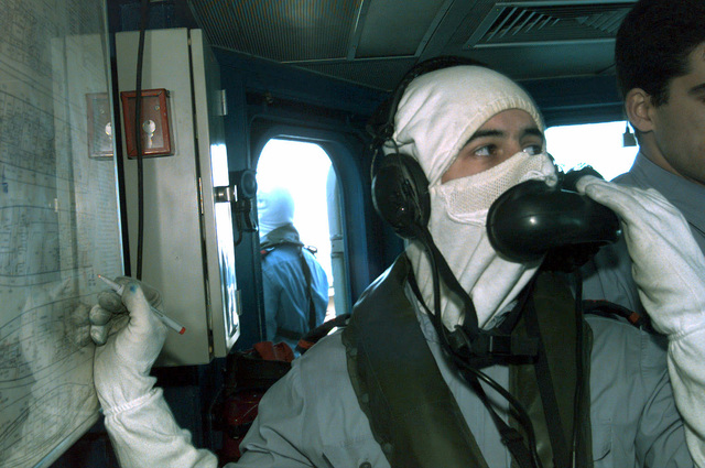 A Portuguese Sailor from the Vasco de Gama Class Frigate, NRP VASCO DE GAMA (F 330), notes simulated battle damage on a status board during a mock air raid by British Tornadoes (Not shown) on March 12th, 1998. The VASCO DE GAMA, along other Portuguese Navy ships and one German frigate (Not Shown) are off the coast of Portugal during exercise Strong Resolve '98, Crisis South