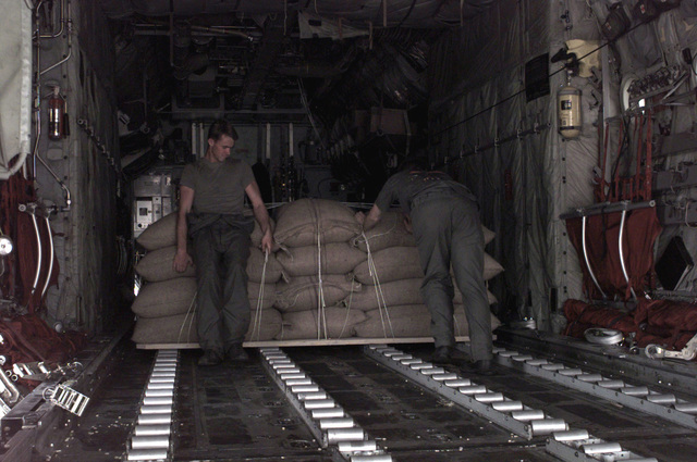 Corporal Shelley and Corporal Dudley, Load Masters from Marine Aerial Refueling Transport Squadron 352 (VMGR 352), load a pallet of food in preparation for a combat off load mission in Wajir, in support of Joint Task Force Kenya, operation Noble Response. (Duplicate image, see also DM-SD-02-05496 or search 980312-M-4605W-001)