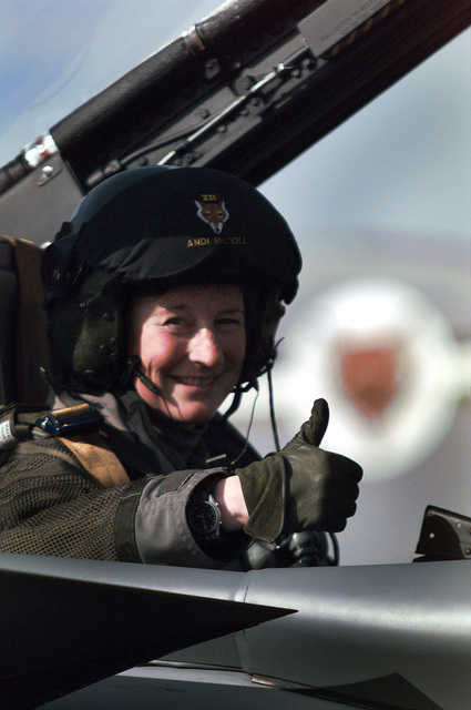 A female navigator from the 12th Royal Air Force Tornado squadron located in Lossiemouth, England, gives a thumbs up on March 20th, 1998, after a final flight over the skies of Portugal during exercise Strong Resolve '98. The Squadron was operating out of the Beja Air Base in Beja, Portugal