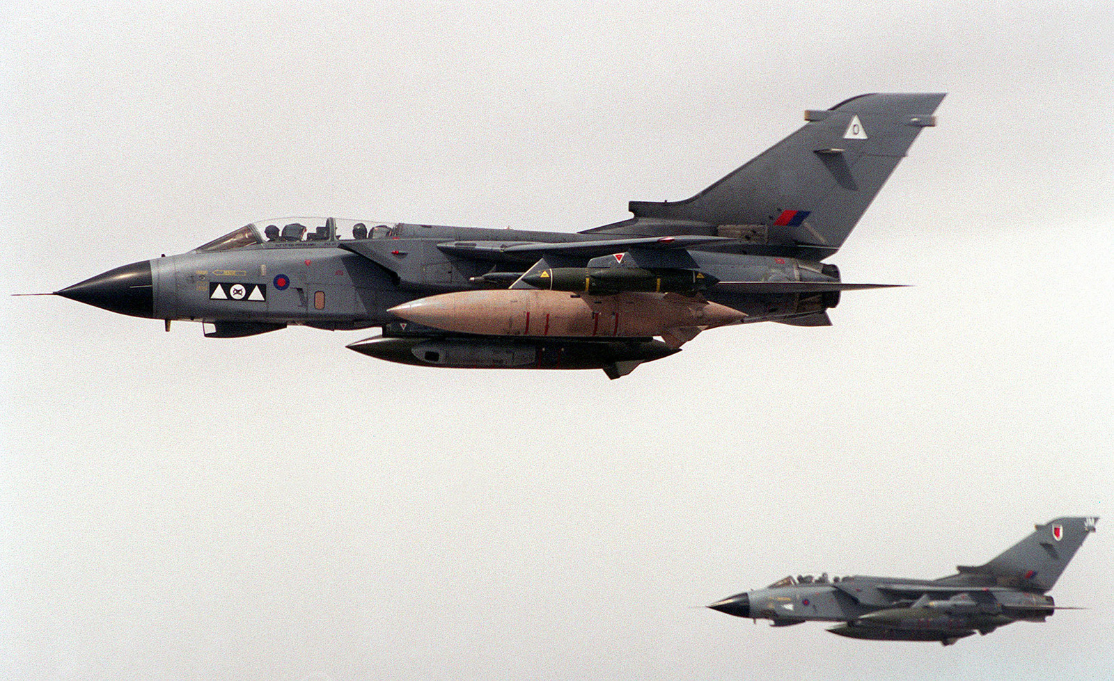 A pair of British Royal Air Force GR-1 Tornados cruise over Kuwait near the Iraqi border as part of the Southwest Asia build-up