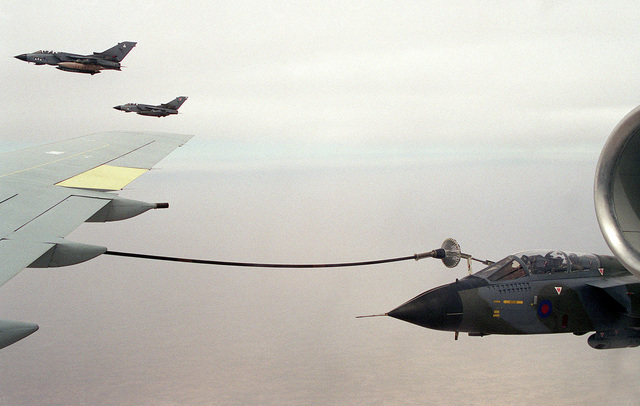 A pair of British Royal Air Force GR-1 Tornados fly off the right wing of a British VC-10 K3 tanker (Partially shown) prior to refueling over Kuwait as part of the Southwest Asia build-up. Another Tornado takes on fuel