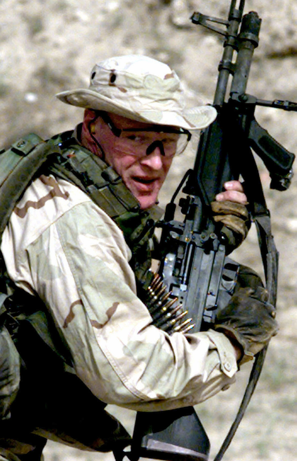 A US Navy SEAL, from SEAL Team 8, manuevers with a M-60