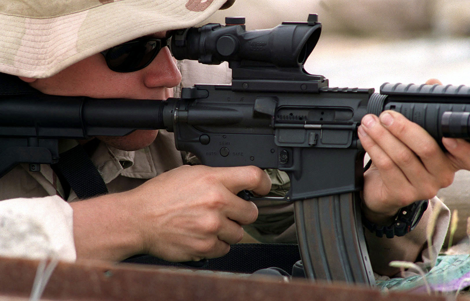 A US Navy SEAL, from SEAL Team 8, shoots a Colt 5 56mm M-4 Carbine