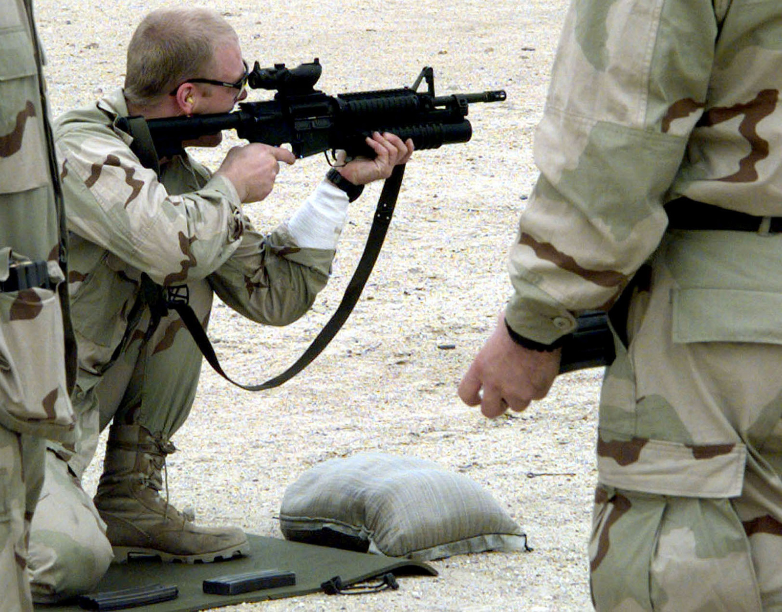 A US Navy SEAL, from SEAL team 8, shoots a Colt 5 56MM M4