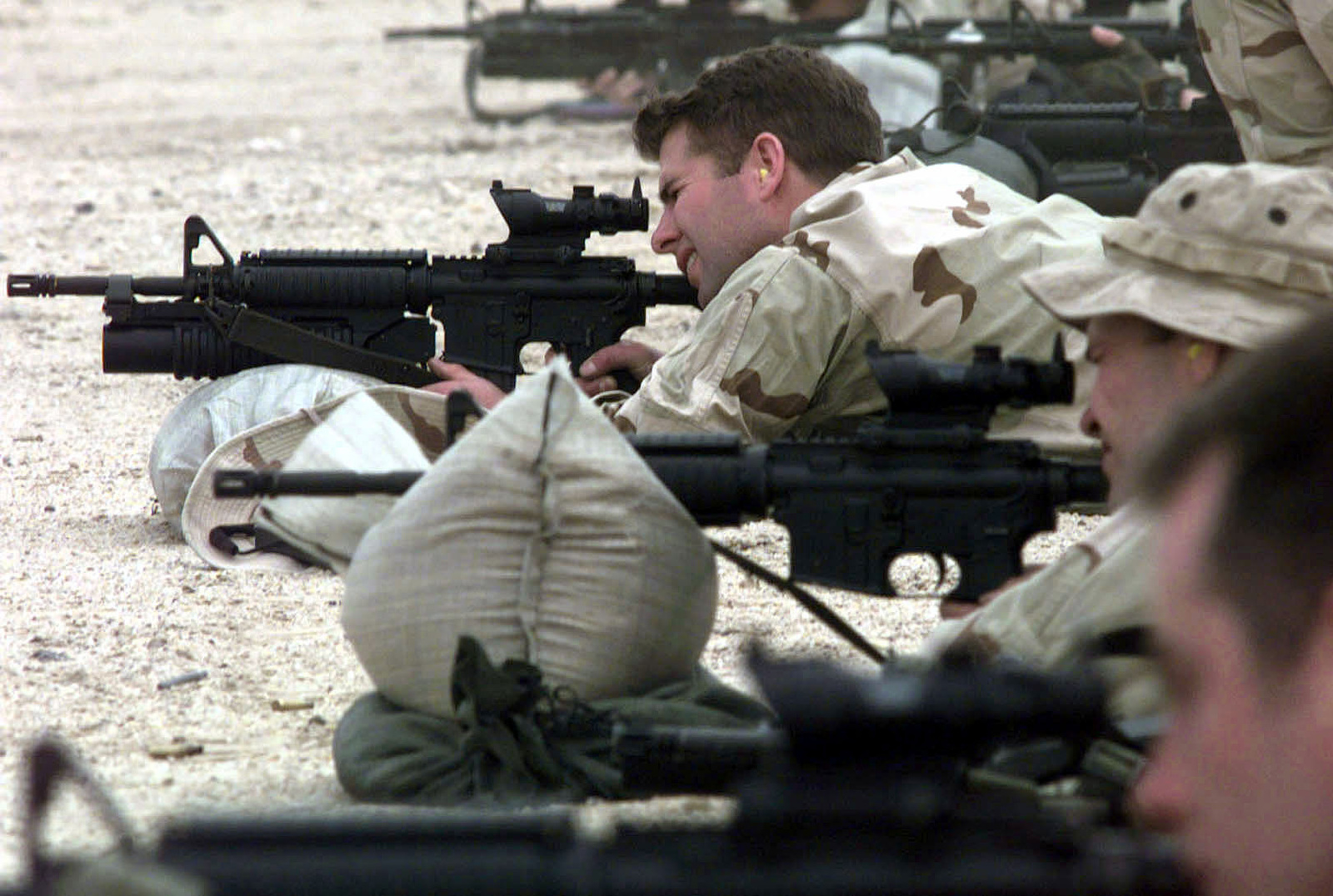 A US Navy SEAL (Third from front), from SEAL Team 8, shoots