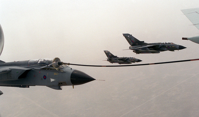 British Royal Air Force GR-1 Tornados conduct air-to-air refueling with a British VC-10 K3 tanker (Partially shown) over Kuwait as part of the Southwest Asia build-up. Two other Gr-1s fly off the left wing of the refueling Tornado