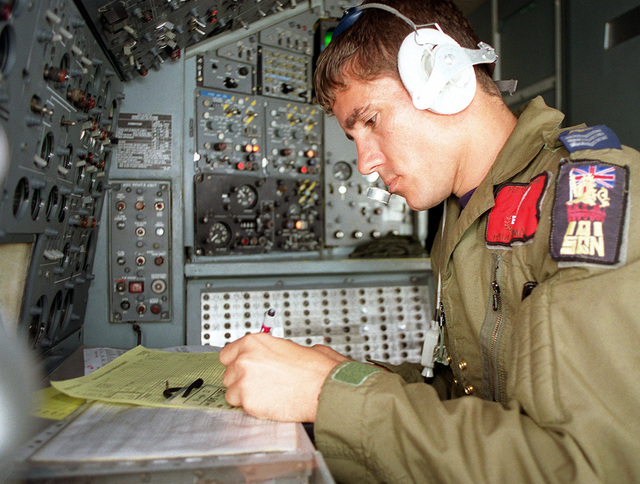 British Royal Air Force Sergeant Paul Kynman, an Air Engineer on a British RAF VC-10 K3 fueling tanker, works in the cockpit during a mission to Kuwait for air-to-air refueling with British GR-1 Tornado jets (Not shown)