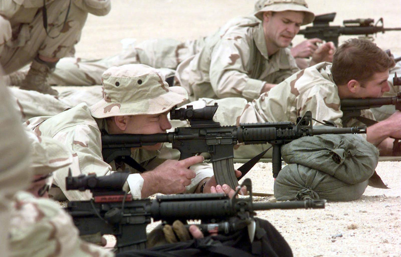 US Navy SEALS, from SEAL Team 8, shoot Colt 5 56mm M-4