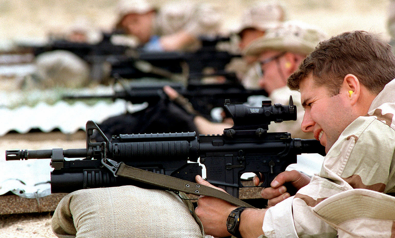 US Navy SEALS, from SEAL Team 8, shoot Colt 5 56mm M-4 Carbine rifles on