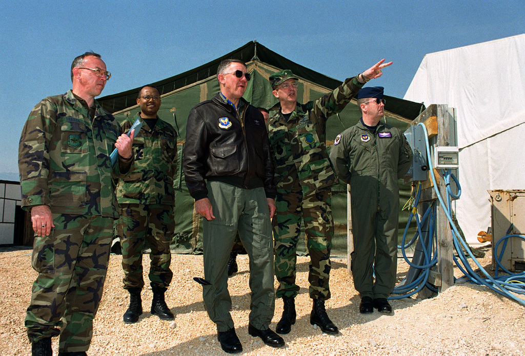US Air Force Lieutenant Colonel Shriver, Commander of Tendopoli TDY Facilities at Aviano Air Base, Italy and Lieutenant General David L. Vesely, USAF Assistant Vice CHIEF of STAFF, watch as Brigadier General Timothy A. Peppe, Commander of the 31st Fighter Wing, points toward some of the Tendopoli TDY facilities