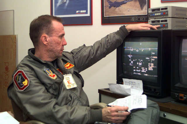 US Air Force Major Mike Roberts, an Air Force Liaison Officer assigned to Shaw AFB, Ohio uses a Sony digital video system to examine aircraft gun camera footage, taken during the 178th Fighter Wing's Operational Readiness Inspection