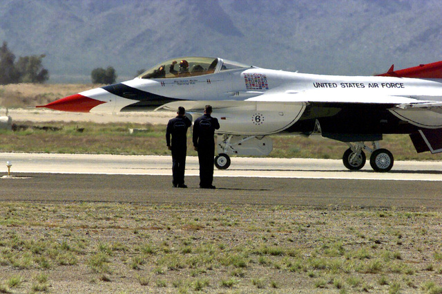 An F-16 Fighting Falcon from the USAF Thunderbird Team taxis out from Luke Air Force Base, AZ at the start of their Luke Day Air Show. The Thunderbirds demonstrated combat formations and capabilities of the F-16 Fighting Falcon