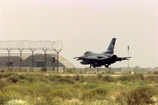 An F-16J Fighting Falcon fighter with the185th Fighter Wing (FW), from the Iowa Air National Guard (ANG), Sioux City, Iowa, on the runway at Ahmed Al Jaber Airbase, Kuwait, in support of Operation SOUTHERN WATCH 1998