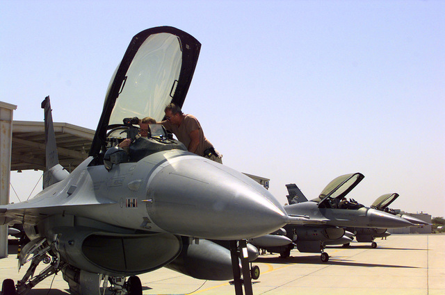 Several F-16J Fighting Falcon fighters assigned to the 185th Fighter Wing (FW), Iowa Air National Guard (ANG), Sioux City, Iowa, prepare to depart Ahmed Al Jaber Airbase, Kuwait, in support of Operation SOUTHERN WATCH 1998