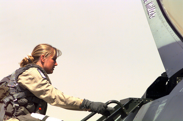 US Air Force (USAF) First Lieutenant (1LT) Bobbi Doorenbos, a pilot assigned to the 185th Fighter Wing (FW), Iowa Air National Guard (ANG), Sioux City, Iowa, climbs into her F-16 Fighting Falcon fighter at Ahmed Al Jaber Airbase, Kuwait, in support of Operation SOUTHERN WATCH 1998
