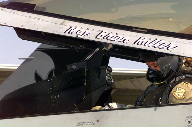 US Air Force (USAF) First Lieutenant (1LT) Bobbi Doorenbos, a pilot assigned to the 185th Fighter Wing (FW), Iowa Air National Guard (ANG), Sioux City, Iowa, sits in her F-16 Fighting Falcon fighter at Ahmed Al Jaber Airbase, Kuwait, in support of Operation SOUTHERN WATCH 1998, prior to launch