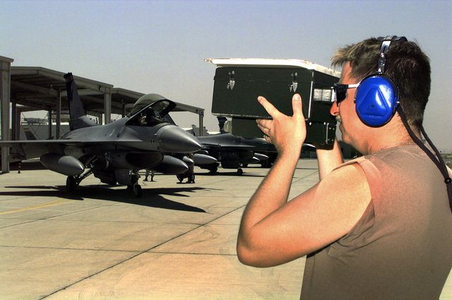 US Air Force (USAF) STAFF Sergeant (SSGT) Darin Winfree, an Avionics Journeyman assigned to the185th Fighter Wing (FW), Iowa Air National Guard (ANG), Sioux City, Iowa, checks an F-16J Fighting Falcon fighters Identify Friend or Foe (IFF) reading at Ahmed Al Jaber Airbase, Kuwait, in support of Operation SOUTHERN WATCH 1998