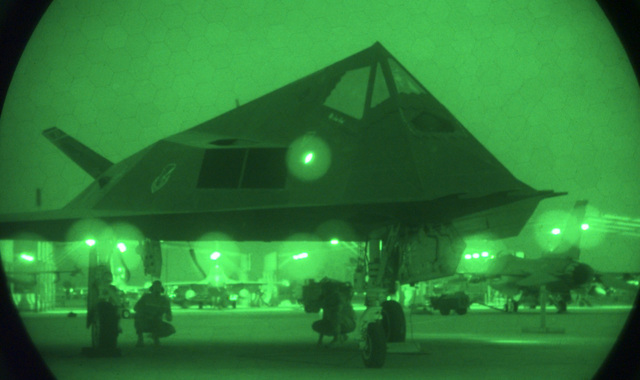 A U S Air Force (USAF) F-117A Nighthawk stealth fighter launching on a mission from the 9th Fighter Squadron (FS), 49th Fighter Wing (FW), Holloman Air Force Base (AFB), New Mexico, at Ahmed Al Jaber Air Base, Kuwait, during Operation SOUTHERN WATCH 1998. Night scope used