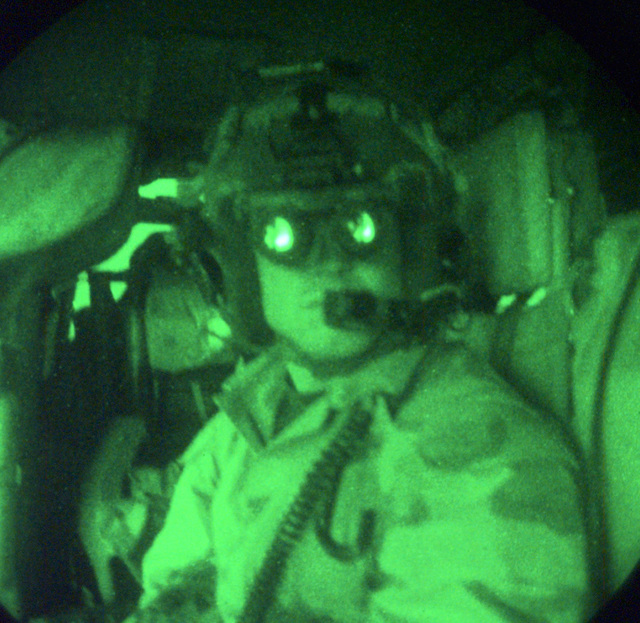 US Air Force (USAF) SENIOR AIRMAN (SRA) Eric Barry, a Pararescue crewman with the 4412th Rescue Squadron (RS)(Provisional) wears night vision goggles while flying as an observer aboard an USAF MH-60G Pave Hawk helicopter, in support of Operation SOUTHERN WATCH 1998. Night scope used