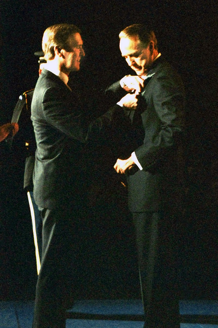 US Secretary of Defense (SECDEF) The Honorable William S. Cohen pins the Department of Defense Public Service Medal on Former US Senator The Honorable Bob Dole, during a Ceremony held at Conmy Hall, Fort Myer, Virginia (VA)