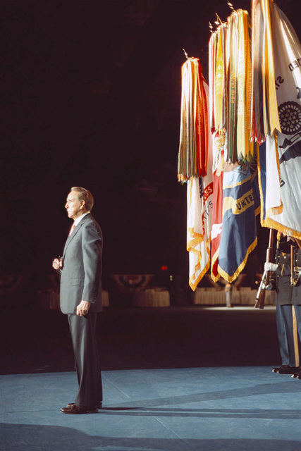 Former US Senator The Honorable Bob Dole stands at attention for the Nation Anthem at Fort Myer's Conmy Hall after receiving the Department of Defense Public Service Medal