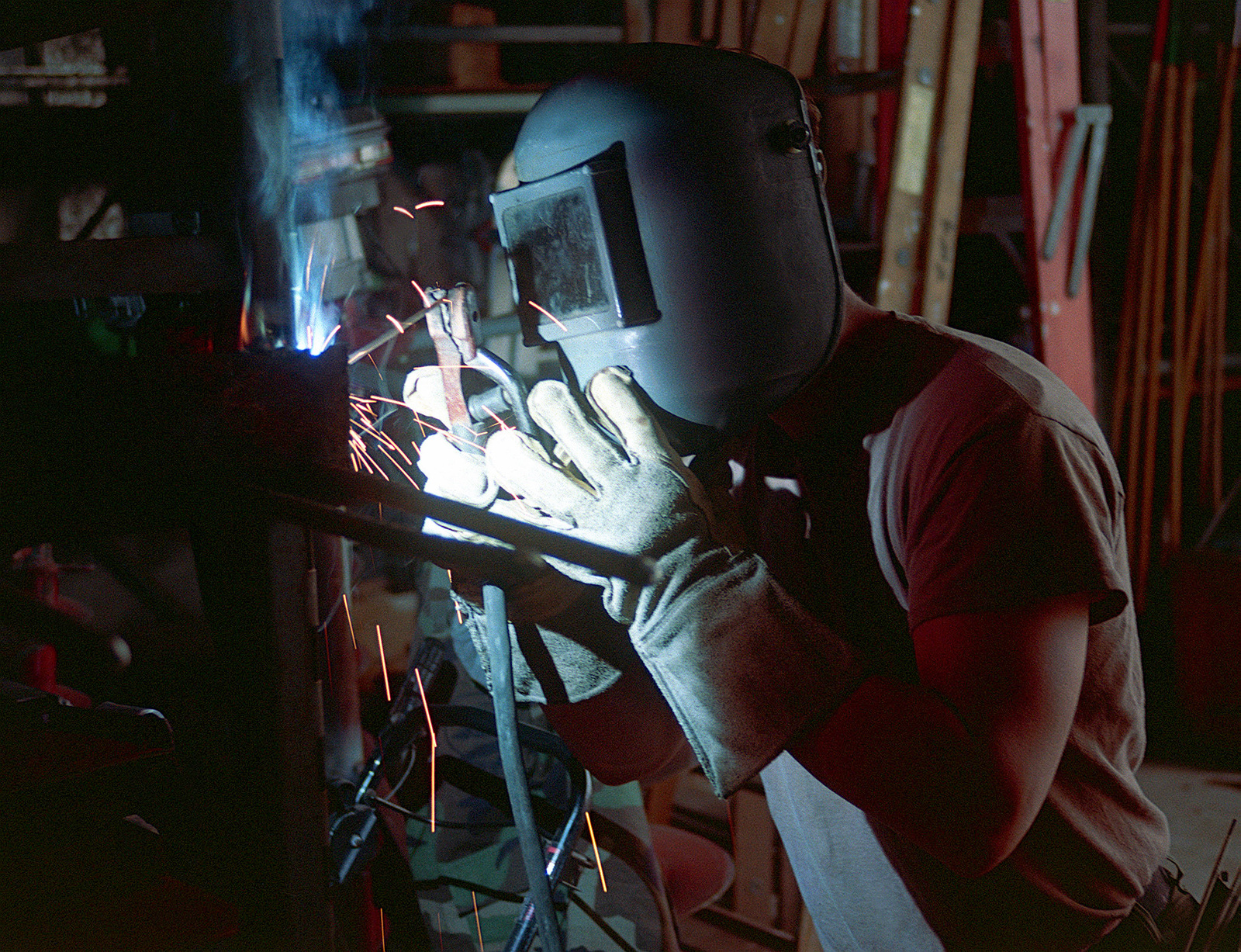 US Navy Steelworker 3rd Class (SW3) Roger Baker, Construction Battalion Unit Four One Zero (CBU-410), arc welds a tool rack at the seabee camp, Naval Air Station Jacksonville, Florida, 7 May 1998